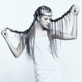 Portrait of young woman with braid hairdo beautiful creative Royalty Free Stock Image