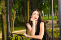Portrait young woman closeup of a beautiful in park Royalty Free Stock Photos