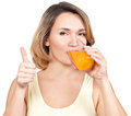 Portrait of a young woman drinks orange juice isolated on white Royalty Free Stock Photography