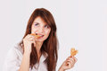 Portrait of young woman eating cookie Royalty Free Stock Photo