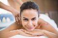 Portrait of young woman enjoying massage close up at health spa Stock Photo