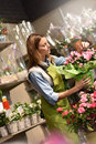 Portrait of young woman in flower shop Royalty Free Stock Photo