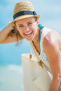 Portrait of young woman with hat and bag at seaside pretty white Royalty Free Stock Images