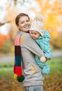 Portrait of young woman and her baby son in park women autumn Stock Photos