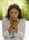 Portrait of a young woman holding a bowl of Chinese tea Royalty Free Stock Photo