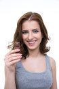 Portrait of a young woman holding chocolate bar Royalty Free Stock Photo