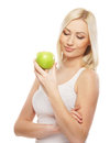 Portrait of a young woman holding a green apple Stock Photos