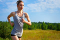 Portrait of young woman jogging in nature a close up Stock Image