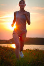 Portrait of young woman jogging in nature a close up Royalty Free Stock Photo