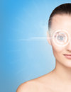 Portrait of a young woman with a laser on her eye close up and beautiful the virtual hologram eyes medicine and security Royalty Free Stock Image