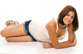 Portrait of young woman lying on floor smiling and looking at yo Royalty Free Stock Image
