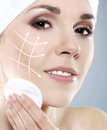 Portrait of a young woman pampering her face close up beautiful and healthy with arrows on spa surgery lifting and make up concept Stock Photos