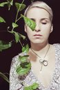 Portrait of a young woman with a passion fruit plant on Stock Images