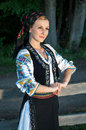 Portrait of young woman posing outside in romanian tra beautiful traditional costume Stock Images