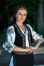 Portrait of young woman posing outside in romanian tra beautiful traditional costume Royalty Free Stock Images