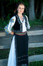 Portrait of young woman posing outside in romanian tra beautiful traditional costume Royalty Free Stock Photos