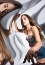 Portrait of young woman with reflection in curved mirrors Royalty Free Stock Photo