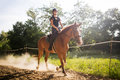 Portrait of young woman riding horse in countryside Royalty Free Stock Photo