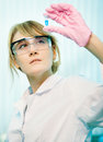 Portrait of young woman scientist in laboratory analyzing liquid in test tube Stock Images