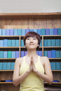 Portrait of young woman with short hair doing yoga with hands clasped together in front women Stock Image