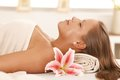 Portrait of young woman sleeping on massage bed Royalty Free Stock Photo