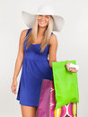 Portrait of a young woman smiling with her shopping bags brunette smilling against white background Stock Photo