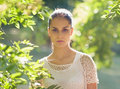 Portrait of young woman standing in foliage Royalty Free Stock Photos