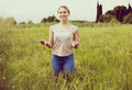 Portrait of young woman standing in wheat field Royalty Free Stock Photo