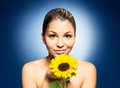 Portrait of a young woman with a sunflower and beautiful girl the over blue background Stock Images