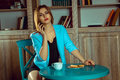 Portrait of young woman talking on the phone and drinking tea Royalty Free Stock Photo