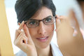 Portrait of young woman trying eyeglasses on Royalty Free Stock Photo
