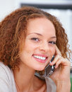 Portrait of a young woman using cell phone Stock Image