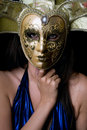Portrait of young woman in a Venetian mask Stock Photo