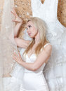 Portrait of the young woman who tries on a white wedding dress near to dreams Royalty Free Stock Photography