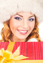 Portrait of a young woman in a winter hat holding a present and happy christmas the image is isolated on white background Stock Image