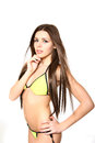 Portrait young woman yellow bikini posing white background Stock Photography