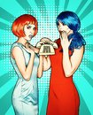 Portrait of young women in comic pop art make-up style. Females in red and blue wigs call on the phone
