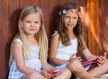 Portrait of youngsters with tablet and smart phone close up two kids outdoors Royalty Free Stock Photos