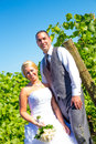 Portraits of bride and groom a outdoors in a vineyard at a winery in oregon right after their ceremony vows Royalty Free Stock Photo