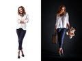 Portraits of pretty woman with suitcase and bear toy isolated studio shot in business outfit on black background Royalty Free Stock Photo