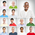 Portraits of smiling multi ethnic men group Stock Photos