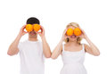 Portraits of young parents with fresh oranges and happy pregnant mother and a father the image is isolated on a white background Royalty Free Stock Photo