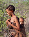 Portrate of bushman woman with child in botswana kalahari desert october young natural their life environment on october kalahari Royalty Free Stock Image
