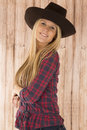 Portriat of an attractive female model with barnwood background portrait cowgirl Stock Photos
