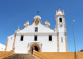 Portugal. Algarve. Portimao. White catholic church on blue sky background. Horizontal view. Royalty Free Stock Photo