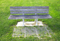Portugal. Bench in a lawn Royalty Free Stock Image