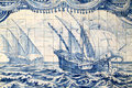 Portugal historical azulejo ceramic tiles lisbon important blue and white wall depicting a caravela sailing ship from the Stock Photo