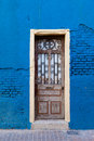 Portugal lisbon old door on the blue wall bright Royalty Free Stock Images