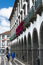 Two lovers hold hands and walk the streets of Ponta Delgada.