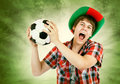 Portuguese fan shouts on the Brazilian colors background Royalty Free Stock Photo